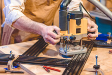 Detail Of A Carpenter Using A Router