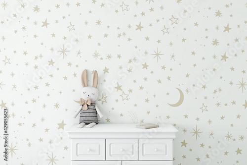 Fototapeta Empty wall with childrens wallpaper golden stars obraz