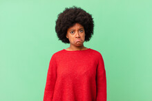Afro Black Woman Feeling Sad And Whiney With An Unhappy Look, Crying With A Negative And Frustrated Attitude