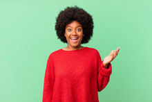 Afro Black Woman Feeling Happy, Surprised And Cheerful, Smiling With Positive Attitude, Realizing A Solution Or Idea