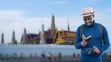 African Traveler Man Travel In Thailand With Holding Passport And Vintage Camera