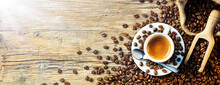 Coffee Espresso Cup With Beans On Wooden Table