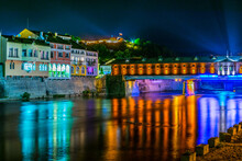 Illuminated Covered Bridge Reflecting On Osam River In The Bulgarian City Lovech