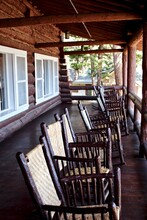 "Yellowstone National Park: Rocking Chairs On The Porch Of  Old Faithful Inn. The Lodge, A National Historic Landmark, Is The Inspiration For ""park-itecture"" Or National Park Service Rustic."