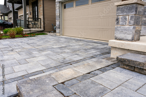 Luxury hardscape driveway shows pavers with pattern and  and matching landing and step. - fototapety na wymiar