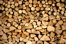Wall Firewood , Background Of Dry Chopped Firewood Logs In A Pile.