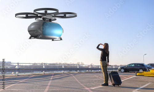 woman waiting for passenger drone transport - fototapety na wymiar