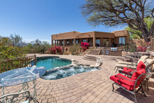Swimming Pool With Hot Tub And Terraced Patio At A Luxury Home In A Desert Environment.