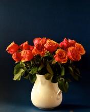 Orange Roses On Black Background