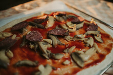 Closeup Shot Of An Uncooked Homemade Pizza With Mushrooms