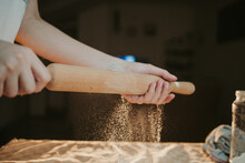 Closeup Shot Of A Person Preparing Dough For Pizza With A Rolling Pin