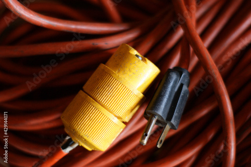 Old worn electrical cord and plug #429144071