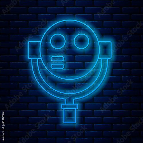Glowing neon line Tourist binoculars icon isolated on brick wall background Wallpaper Mural