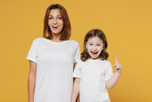 Happy Woman In Basic White Tshirt Have Fun With Child Baby Girl 5-6 Years Old Raised Finger Up Idea Mom Little Kid Daughter Isolated On Yellow Color Background Studio Mother's Day Love Family Concept