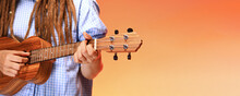 Faceless Portrait Of Funny Young Woman Playing Ukulele. Happiness And Carefree Concept