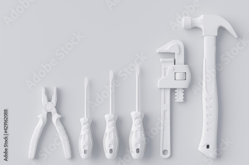 Photo Top view of monochrome construction tools for repair and installation on white