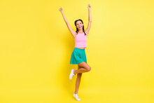 Full Length Photo Of Lucky Astonished Young Lady Braids Dressed Singlet Rising Fists Isolated Yellow Color Background