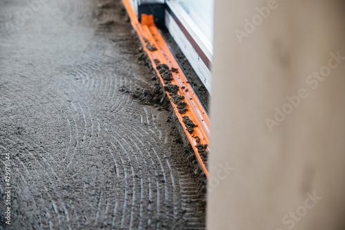 Obraz pouring floors in a single-family house - fototapety do salonu