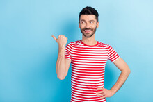 Photo Of Handsome Positive Young Man Point Finger Thumb Empty Space Look News Isolated On Blue Color Background
