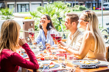 Multiracial People Drinking Red Wine At Open Bar Restaurant - Group Of Friends Laughing Having Fun Dining Together Outdoor -  Bright Filter