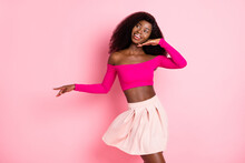 Photo Of Dreamy Lady Dance Palm Chin Look Empty Space Wear Cropped Top Mini Skirt Isolated Pink Background