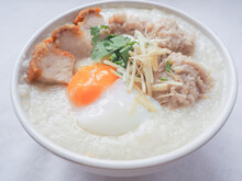 Top View Of Rice Porridge With Minced Pork, Soft-boiled Egg, Sliced Ginger And Deep-fired Pork