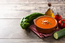 Gazpacho Soup In Crock Pot And Ingredient On Wooden Table