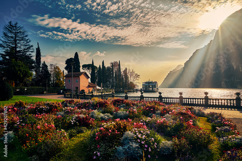 View of the beautiful Lake Garda surrounded by mountains, Scenic view of sunset at Lake Garda in the Riva del Garda with the beautiful sunset colors, italy