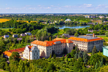 Panoramic Aerial View Of Historic City Center With Primate Seminary Clerical Complex And Jezioro Swietokrzyskie Lake In Gniezno, Poland