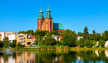 Cathedral Of Virgin Mary Assumption And St. Wojciech At Lech Hill Across Jelonek Lake In Old Town Historic City Center Of Gniezno In Grater Poland