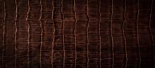 茶色いワニの革の背景テクスチャー