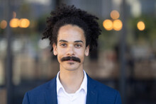 Portrait Of Mixed Race Male With Moustache Looking To Camera