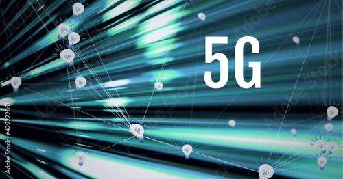 Composition of 5g text over green light trails and network of connections with light bulb icons