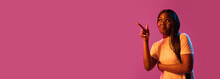 African Young Woman's Portrait On Pink Studio Background In Neon. Concept Of Human Emotions, Facial Expression, Youth, Sales, Ad.