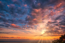 Beautiful Cloudscape And Dramatic Sunset Over Mountain And Sea.
