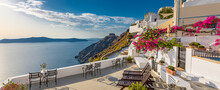 Summer Vacation Panorama, Luxury Famous Europe Destination. White Architecture In Santorini Island, Greece. Travel Landscape Cityscape With Pink Flowers, Stairs, Caldera View In Sunlight And Blue Sky