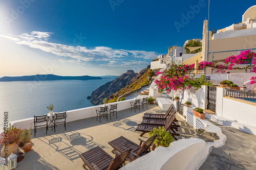 Summer vacation panorama, luxury famous Europe destination. White architecture in Santorini island, Greece. Travel landscape cityscape with pink flowers, stairs, caldera view in sunlight and blue sky - fototapety na wymiar