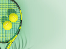 Tennis. Spring Sport Composition With Yellow Tennis Ball And Racket On A Green Background Of Tennis Court With Copy Space. Sport And Healthy Lifestyle. The Concept Of Outdoor Game Sports. Flat Lay