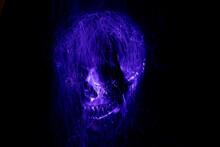 Photo In The Style Of Light Painting, Abstract, Skull On A Black Background