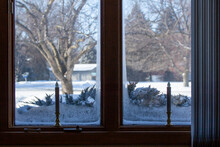 This Image Features An Abstract Texture Background Of An Ice Frosted Window With Holiday Candlesticks On Its Window Sill, Showing An Outdoor Winter Snow Landscape View.