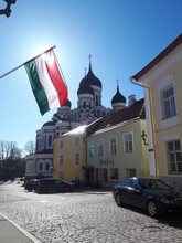 Russian Church With A Hungarian Flag  Where The Flag Cover Up The Sun
