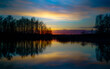 canvas print picture - sunset at coast of the lake. Sunset sky. Smooth water