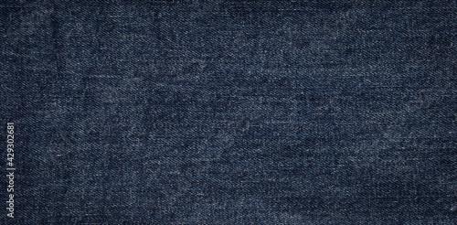 Photo texture of dark blue jeans denim fabric background