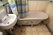 Old Home, Trailer, Cabin Or Cottage Bathroom With Faux Tile Linoleum, Retro Style, And Claw Foot Tub Remodel