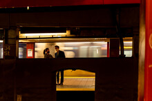 A Couple Waiting The NYC Subway