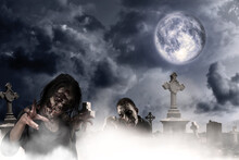 Scary Zombies At Misty Cemetery Under Full Moon. Halloween Monster