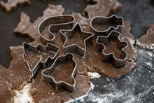 Assortment Of Tiny Cookie Cutters Pressed Into Gingerbread Dough