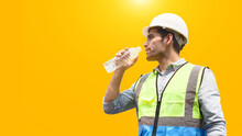 The Construction Worker Drinks Water To Quench His Thirst.