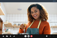 Happy Smiling Young African American Woman Making Video Call While Cooking In Kitchen At Home