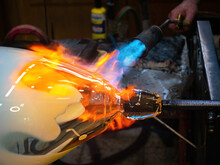 Glass Artist Fires A Glass Ball With A Gas Torch So That He Can Shape It By Hand